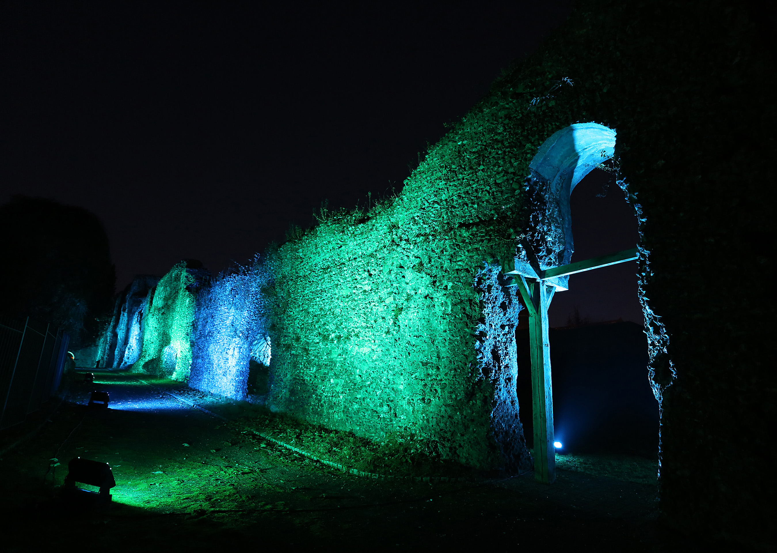 Reading Abbey lit up in green light